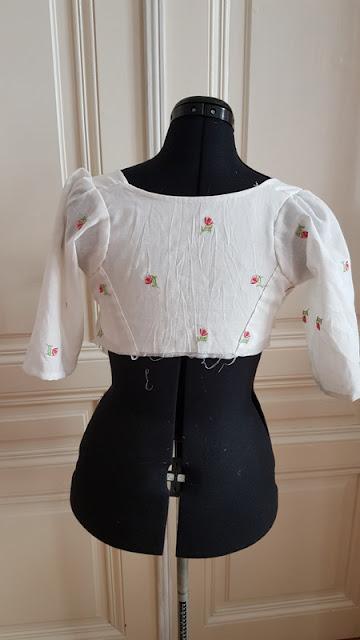 back bodice of a regency dress on a black dress doll