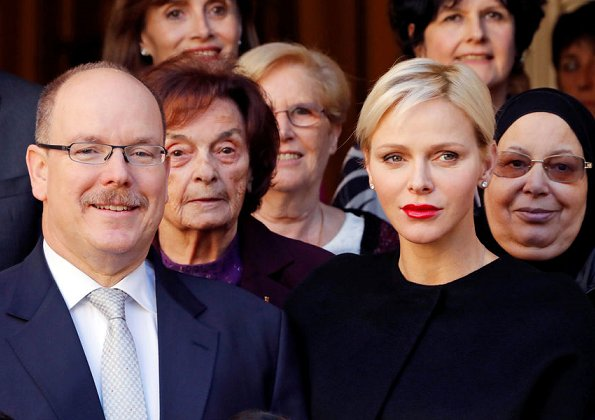 Monaco National Day 2017 christmas gifts ceremony. Princess Charlene wore Akris Stretch Silk Jumpsuit