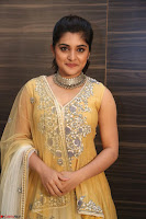 Nivetha Thamos in bright yellow dress at Ninnu Kori pre release function ~  Exclusive (69).JPG