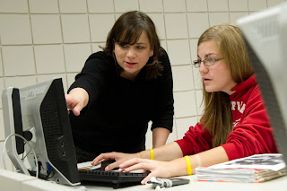 Charlsye (right) works with a student at the University of Maine