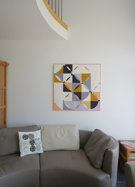 Luna Lovequilts - Free Form Curve quilt hanging in my living room