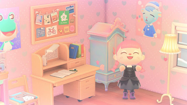 A photo of a bedroom on the game Animal Crossing New Horizons. It is filled with kawaii furniture. There is a pink haired character clapping and smiling