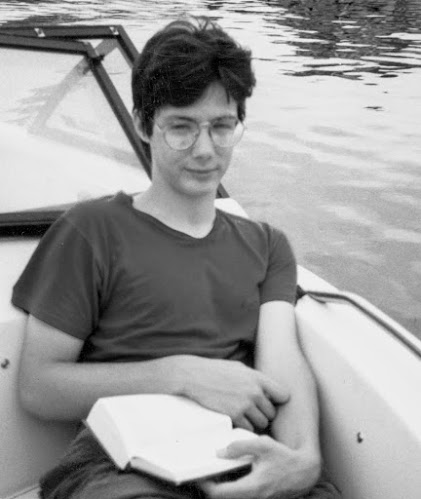 Greig Roselli as a teenager sitting in his mom's boat on the Tchefuncte River reading Catch-22.