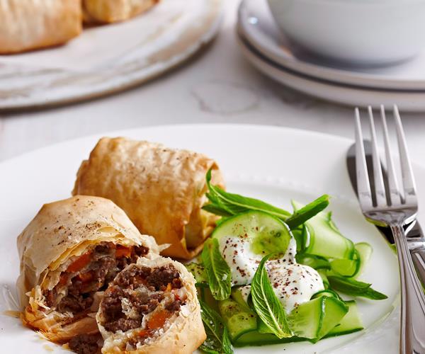 Lebanese lamb rolls an fork in a serving dish