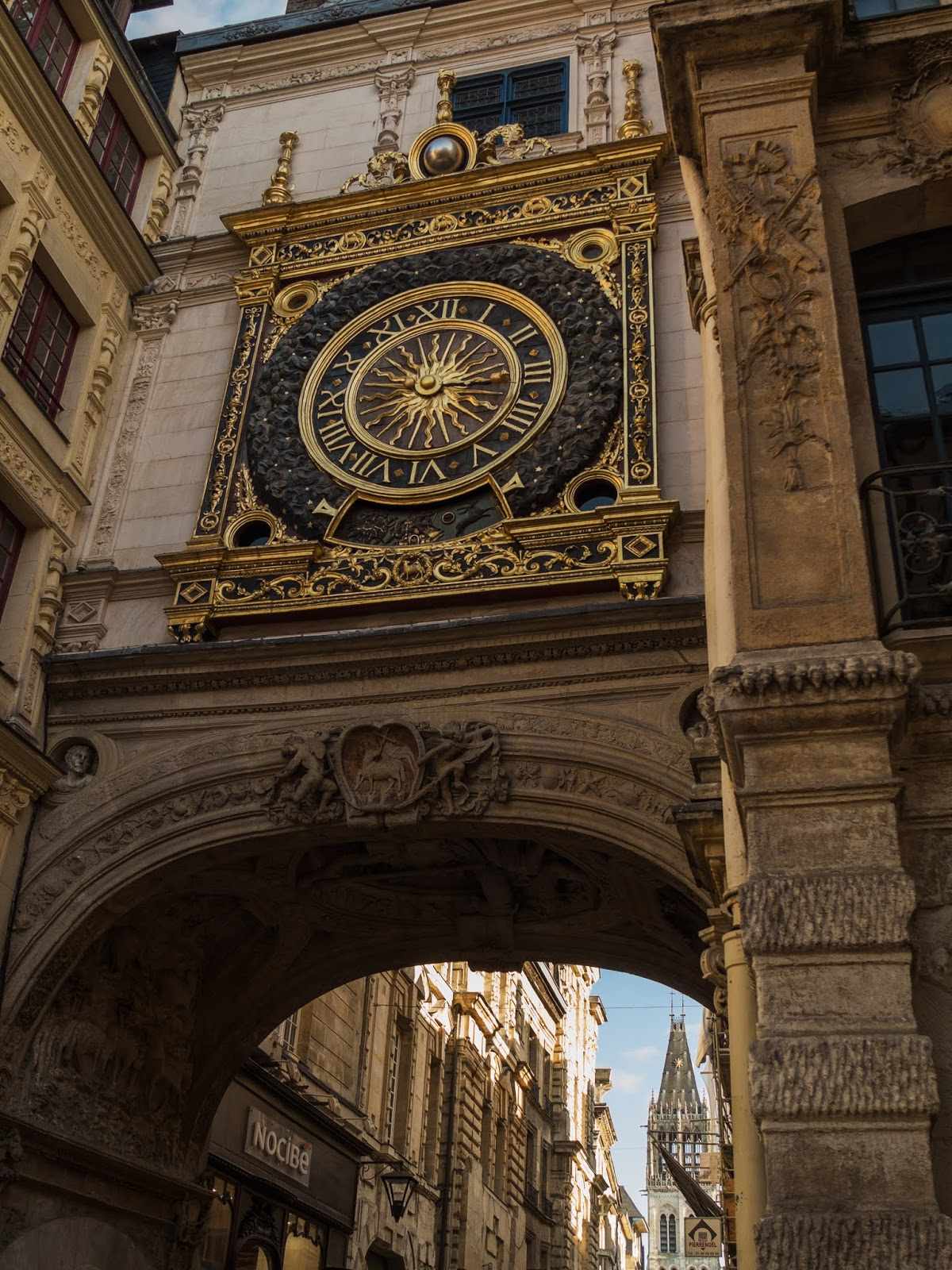 The Gros Horloge above an archway in Rouen, France.
