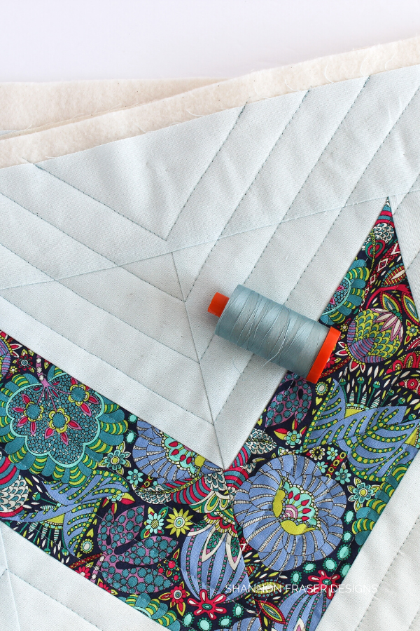 Aurifil Thread featured in the Double Chevron pillow | Shannon Fraser Designs #modernquilting #pillowpattern #aurifilthread