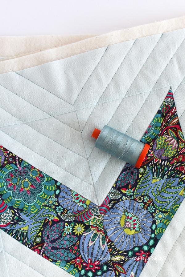 Aurifil Thread featured in the Double Chevron pillow | Shannon Fraser Designs #modernquilting #pillowpattern #aurifilthread