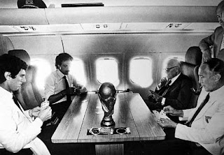 Pertini was pictured playing cards with Dino Zoff, Franco  Causio, and Enzo Bearzot on the plane home from Spain