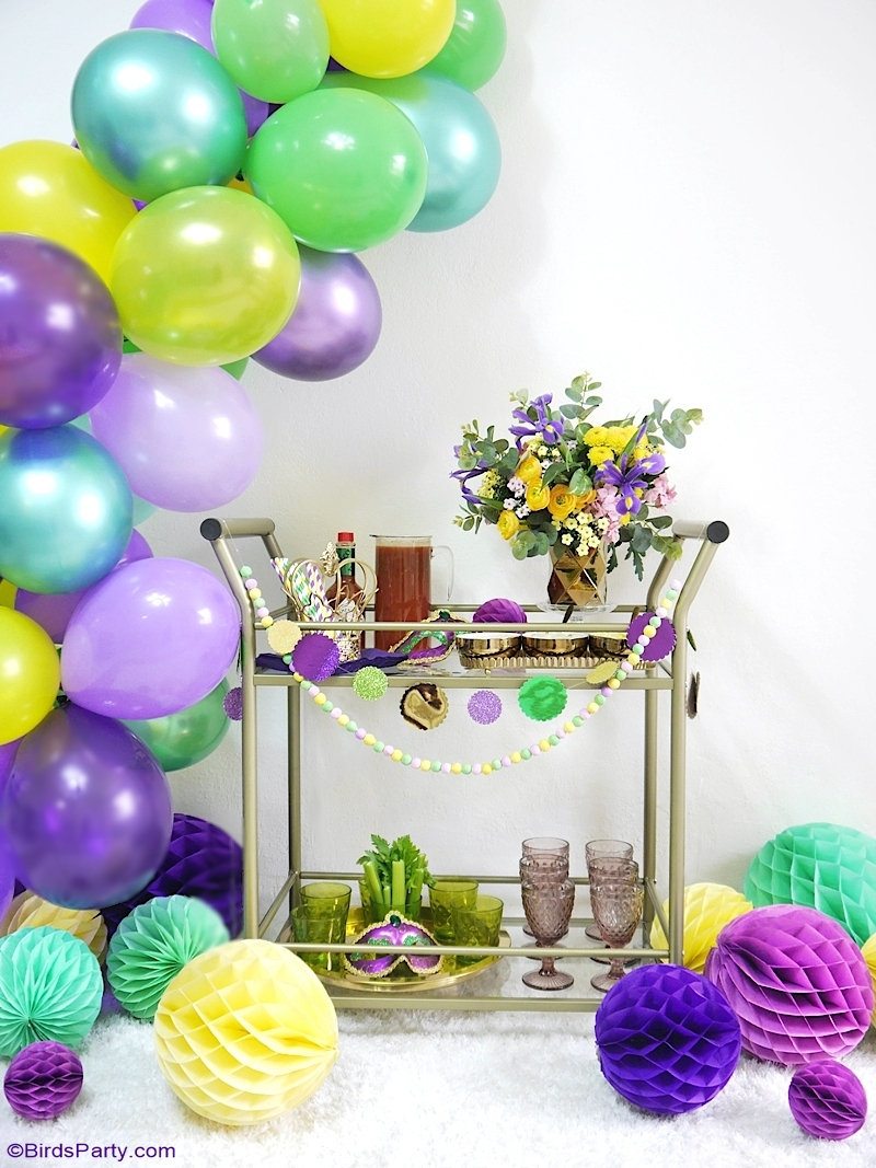 Mardi Gras Bar Cart Styling Ideas + Cajun Bloody Mary Recipe - easy DIY crafts and decor ideas + a delicious cocktail to serve at a Mardi Gras party! by BirdsParty.com @birdsparty #cocktail #cocktailrecipe #recipe #drinksrecipe #mardigras #barcart #barcartstyling #diymardigradecorations #mardigrasdecorations #mardigrasrecipes #bloodymary #bloodymarycocktail #bloodymaryrecipe #cajunbloodymary