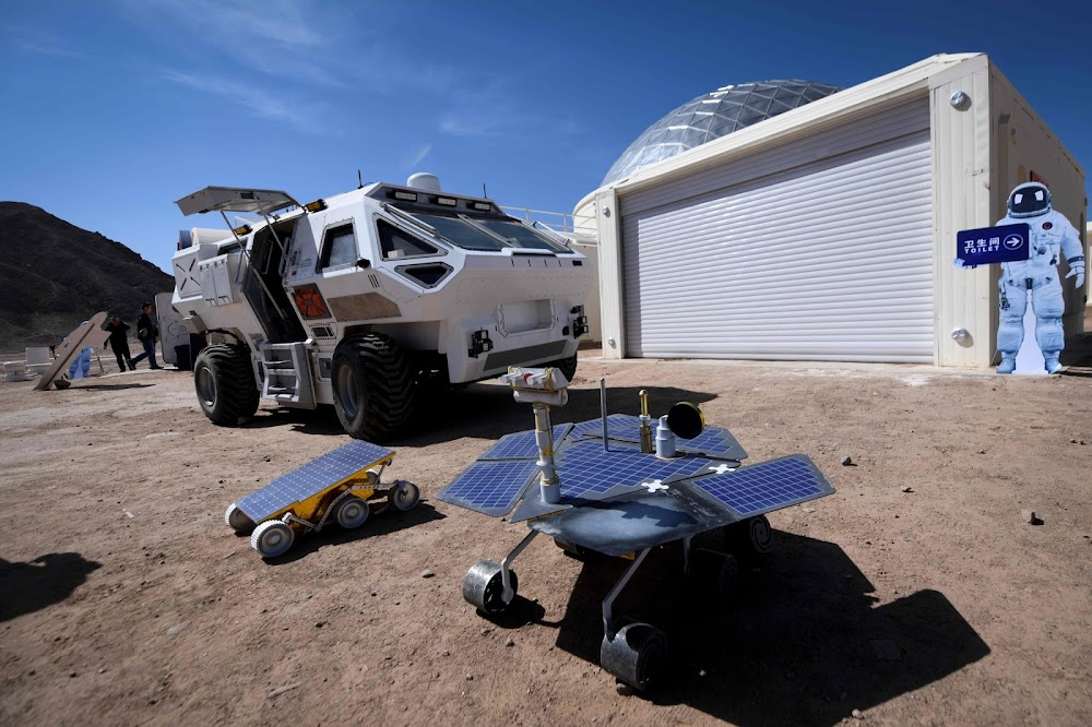 China's C-Space Mars simulation base in Gobi desert (rover parked at base)