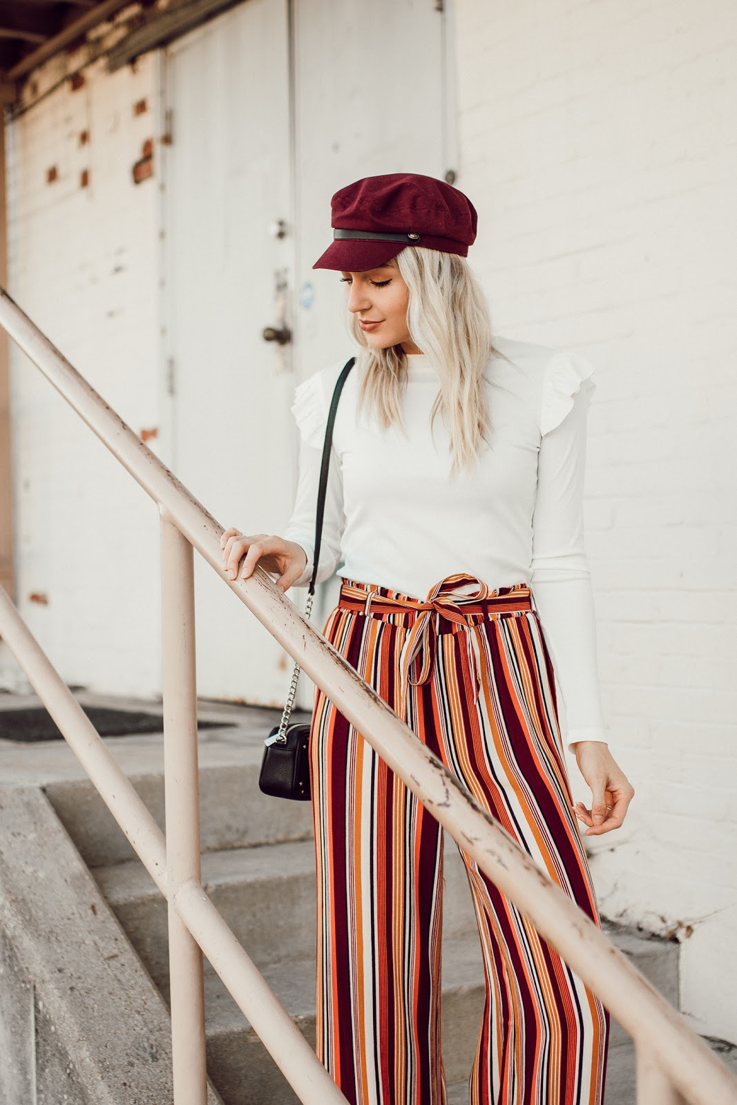 burgundy hat, ruffle top, stripe pants