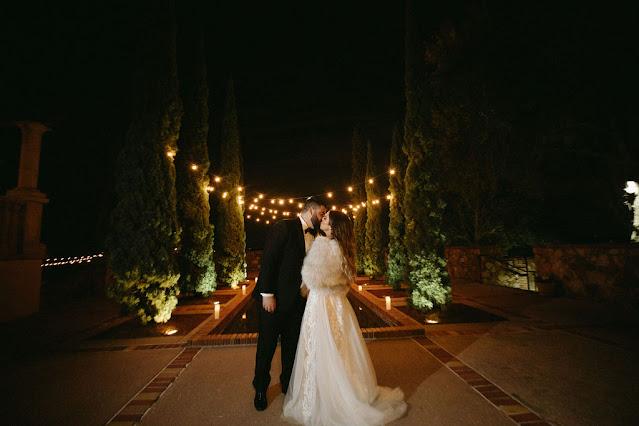 bride and groom at night at bella collina