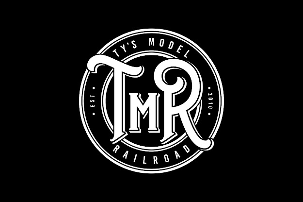Ty's Model Railroad white circular logo on a black background
