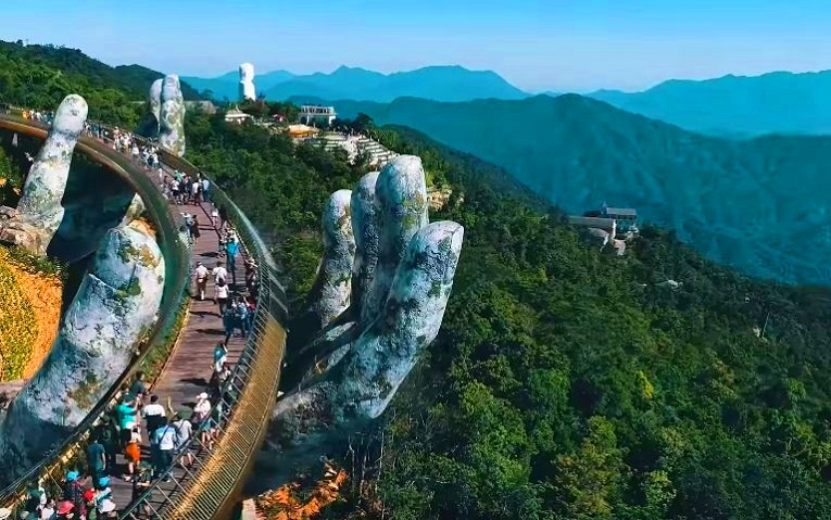 Golden Bridge, Vietnam -  A beautiful pedestrian bridge Lifted up in the air by a pair of giant hands