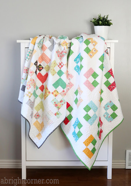 Two baby quilts by Andy of A Bright Corner - charm pack quilt patterns from Perfect 5 Quilts book