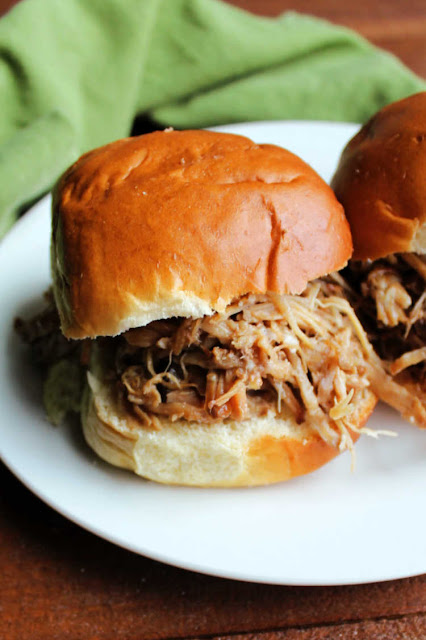 Asian style pineapple pulled pork sandwich on plate