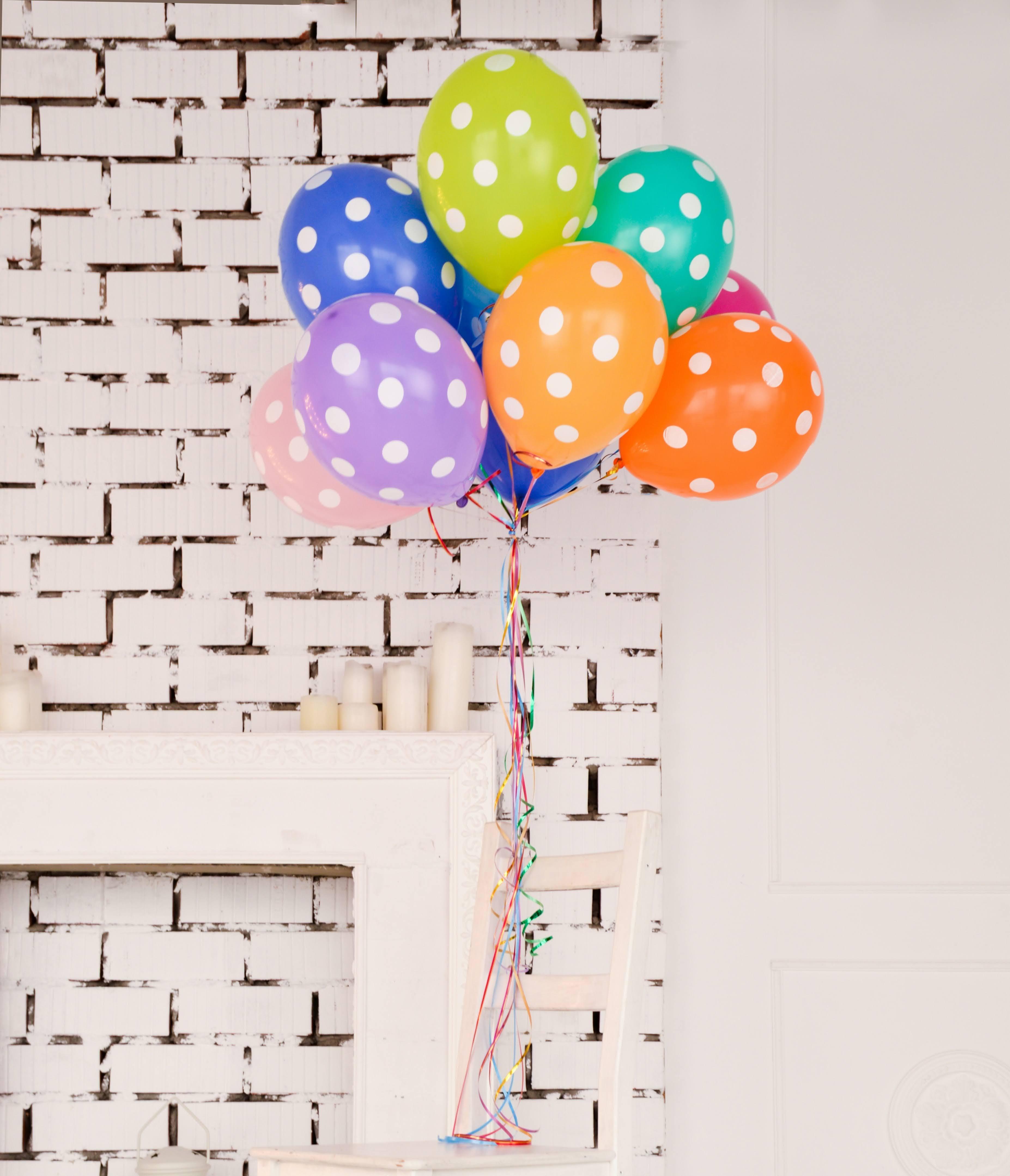 Assorted Color Polka Dot Balloons | Photo by Sofiya Levchenko via Unsplash