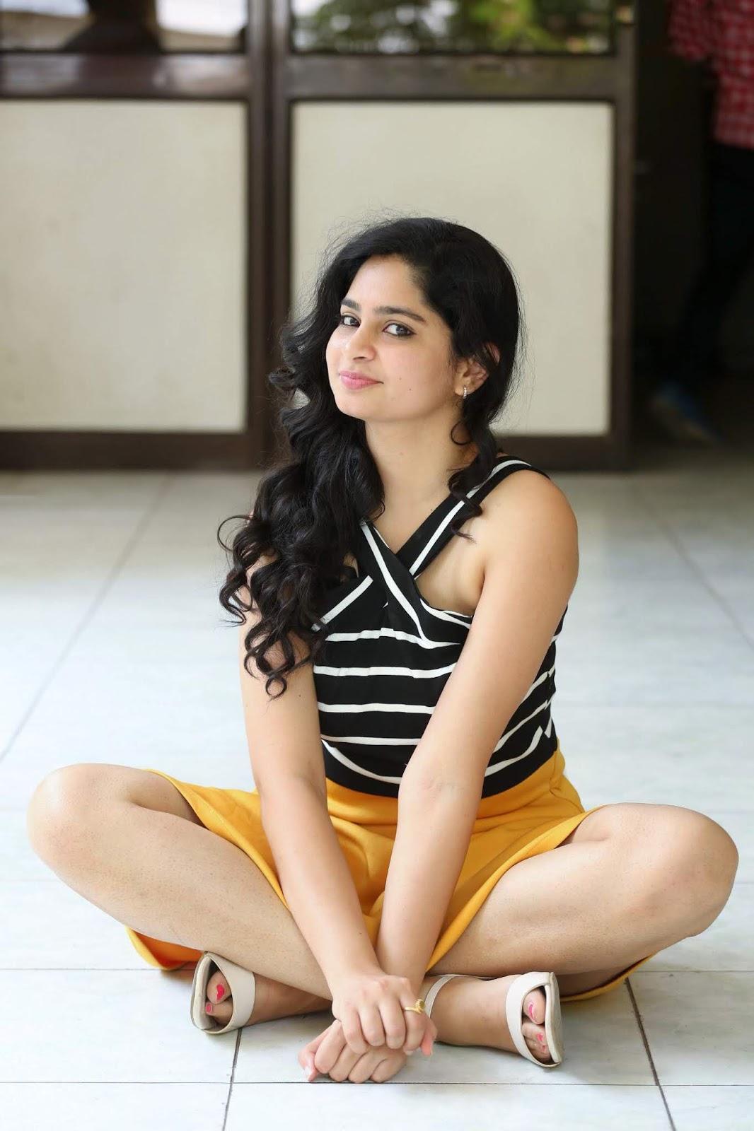 Purvi Thakkar in Orange Mini Skirt and Spicy Sleeveless Black Tank Top Stunning Pics