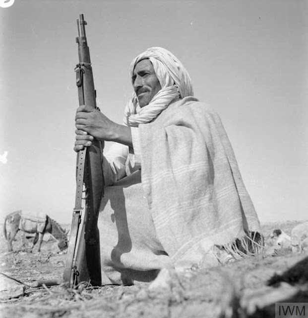 Arab with rifle, 4 April 1942 worldwartwo.filminspector.com