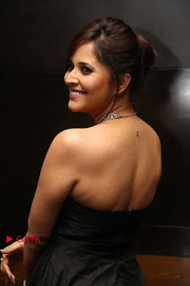 Telugu Anchor Actress Anasuya Bharadwa Stills in Strap Less Black Long Dress at Winner Pre Release Function  0032.jpg