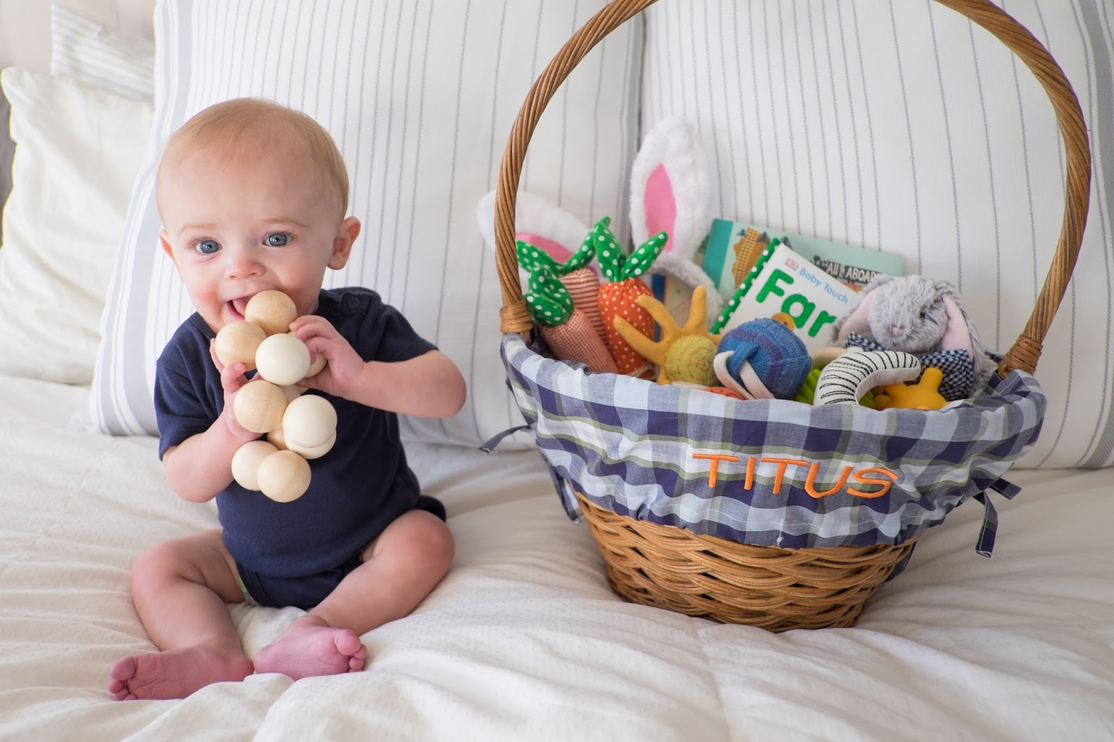 Domestic fashionista babys first easter photos the basket was full of colorful spring gifts a few toys and books that i wanted for him as well as some eastery things to help fill out the basket and look negle Images