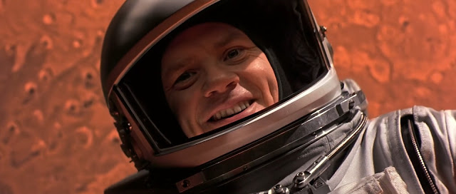Smiling astronaut in Mars orbit - Mission to Mars movie image