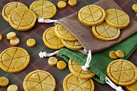 Homemade pumpkin dog treats stamped to look like pies with drawstring treat bags