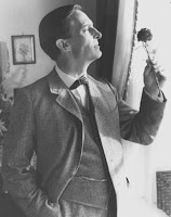 Jeremy Brett as Sherlock Holmes with a rose in the Granada adaptation