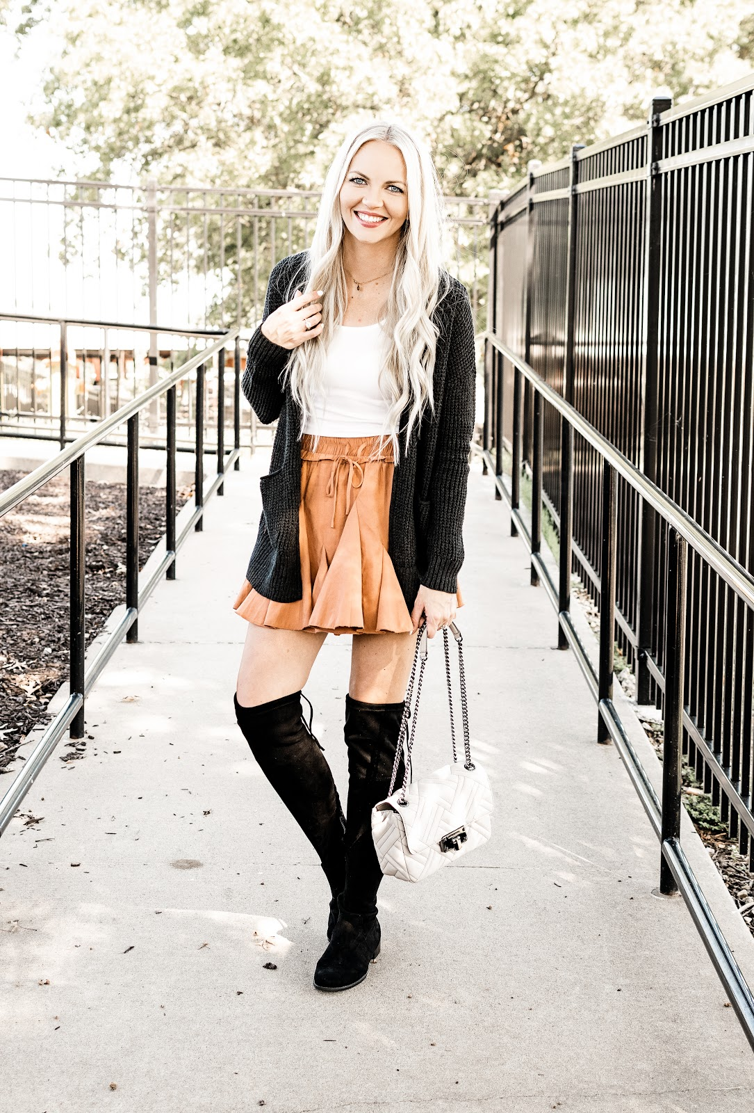 One Rust Skirt + Fall Staples = Endless Outfits fall outfit ideas pleated skirt orange skirt burnt orange rust sneakers leopard denim jacket black henley basic tanks beige cardigan black cardigan gray cardigan over the knee boots superga platform sneakers