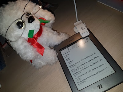 Image: Stuffed Dog wearing Glasses with an Amazon Kindle