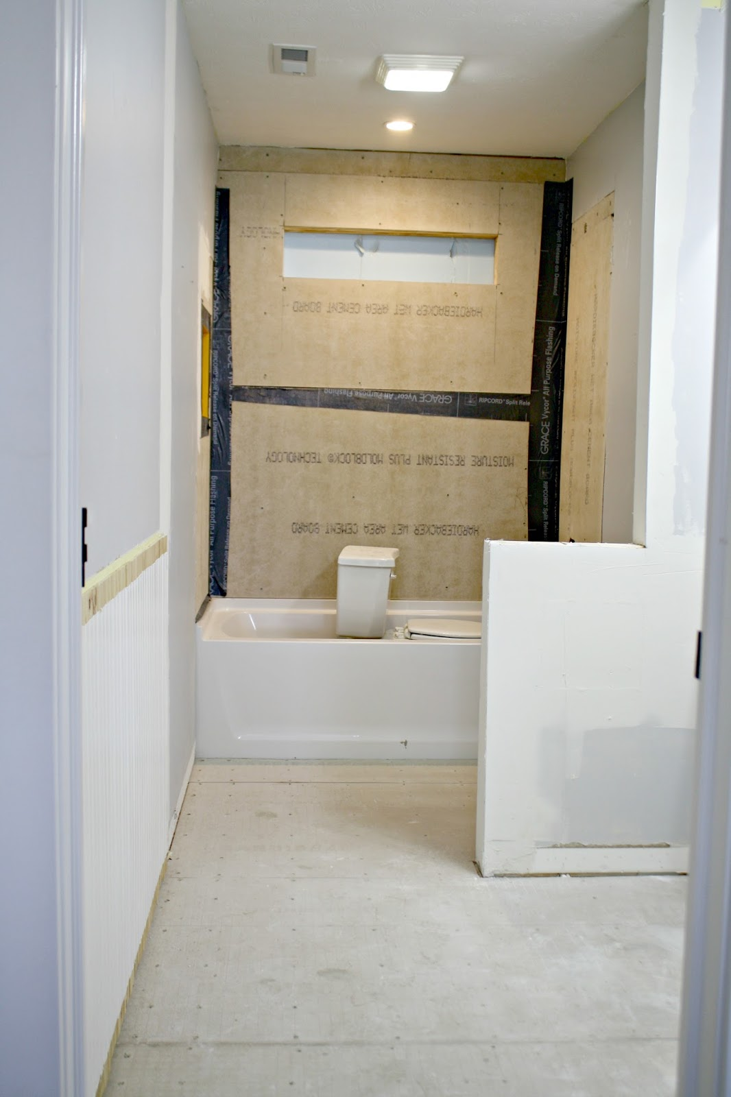 Bathroom updates and help me pick out the tile from thrifty decor removing wall in bathroom dailygadgetfo Image collections