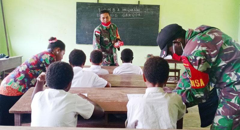 Ajarkan Nasionalisme Sejak Dini Satgas Tmmd Ke 109 Gelar Lomba Warnai Burung Garuda Anak Sd Di Papua Laras Post