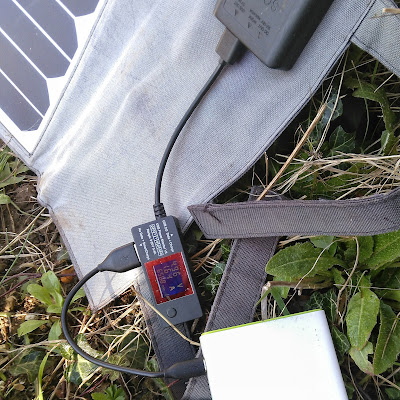 Close-up of solar panel hooke dup to battery with USB power monitor