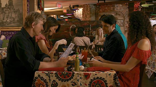 Johnny, Daniel, Carmen, and Amanda eat dinner