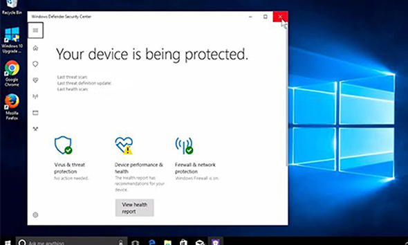 Start updating windows 7 to windows 10,Windows defender,windows defender security center window in white colour written your device is being protected kept open on windows 10 desktop,
