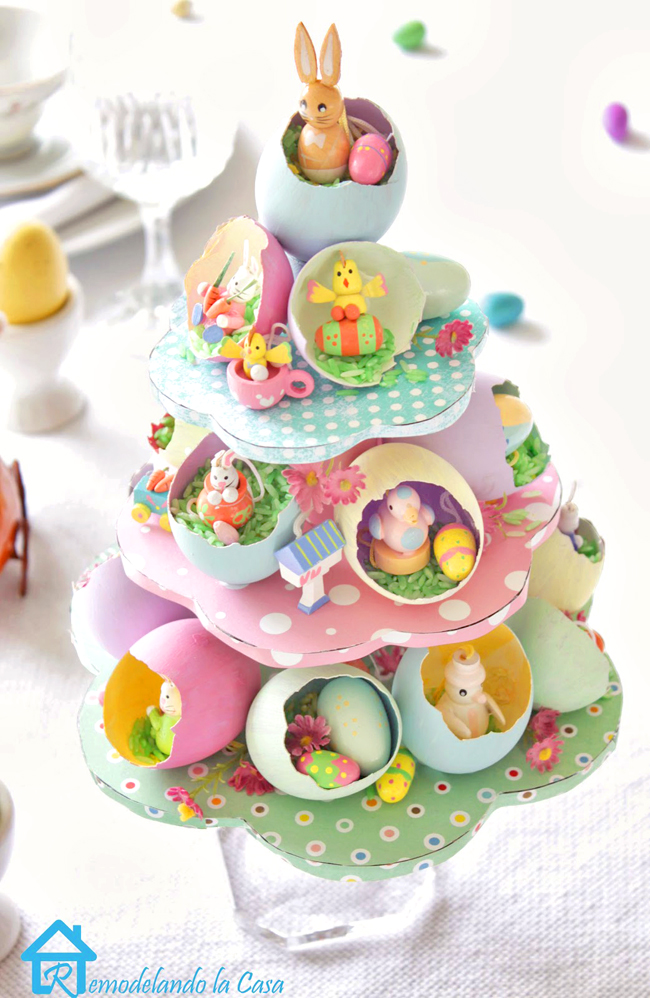 Easter egg tree with little Easter figures on easter table