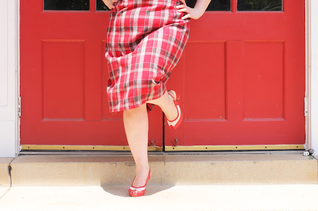 red plaid skirt and vintage style heel shoes with a red door