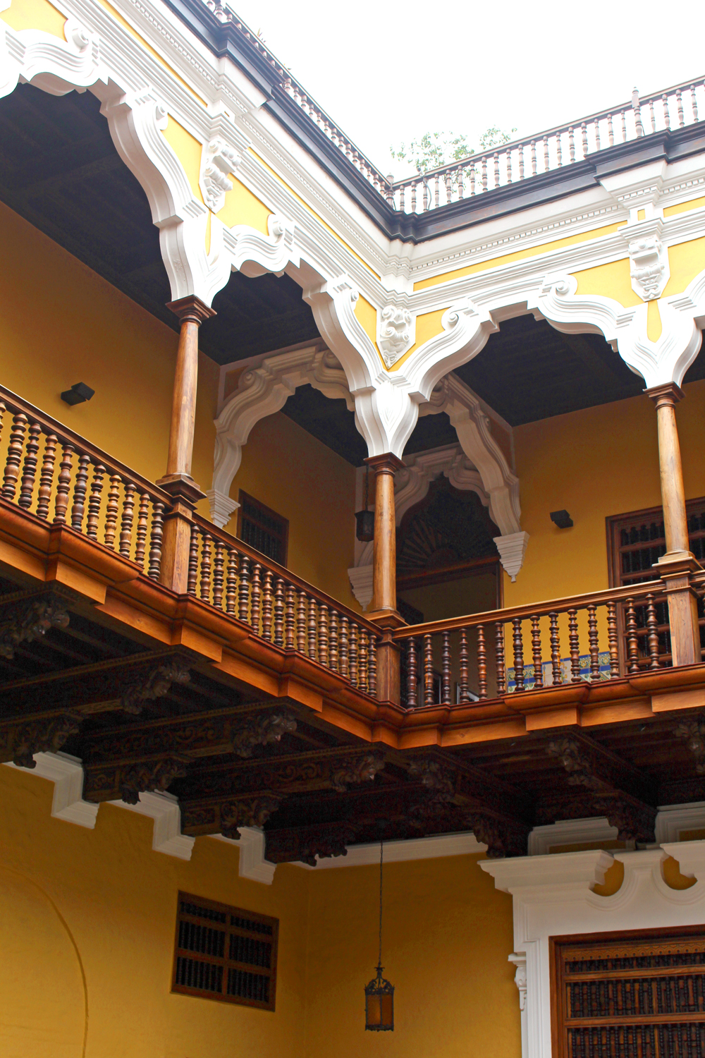 Yellow wooden balcony in Lima, Peru - travel blog