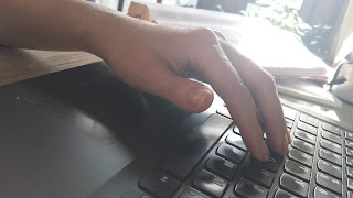 Picture of hand on keyboard