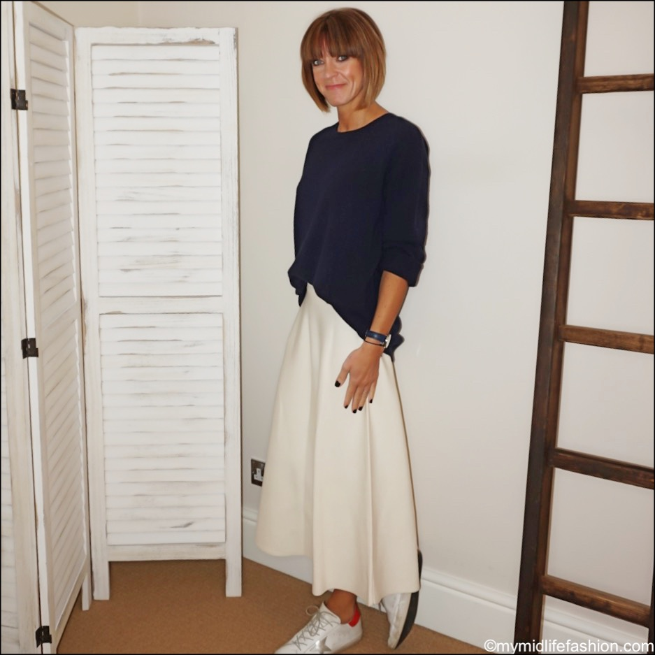 my midlife fashion, H and m oversized crew neck jumper, next a line skirt, golden goose superstar low top leather trainer
