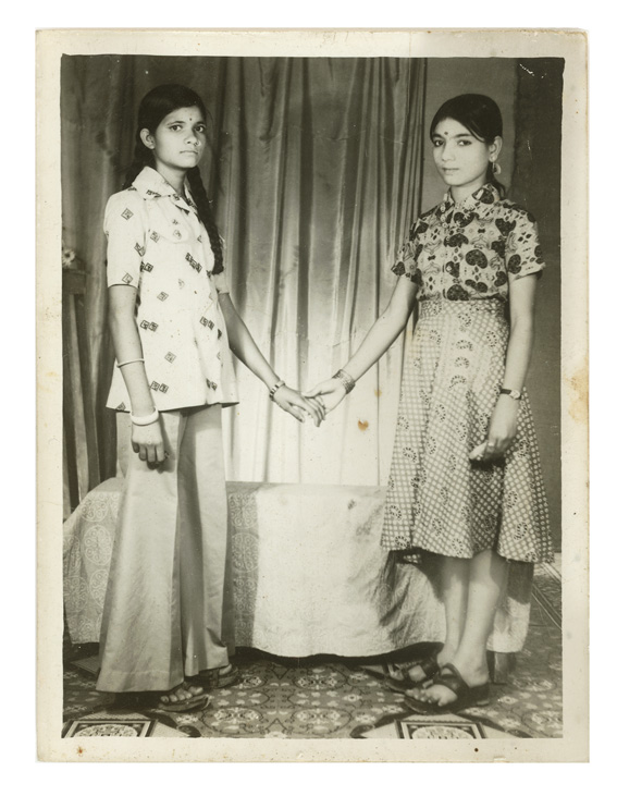 Two Indian Girl Holding Each Others Hand