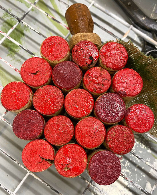 red painted corks with stem and leaf