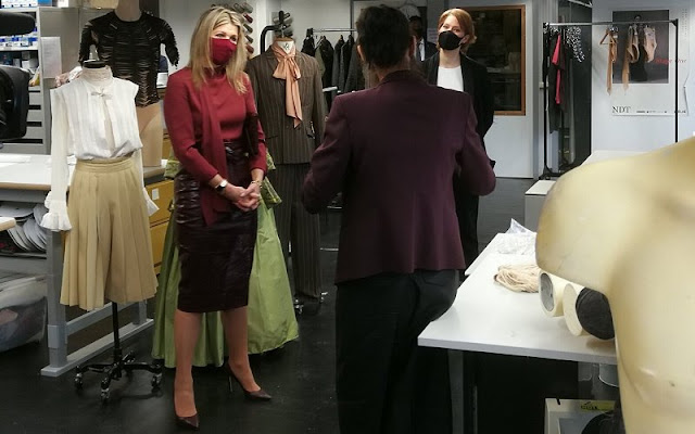 Queen Maxima wore a red wool coat from Natan, and burgundy leather skirt and silk blouse from Natan