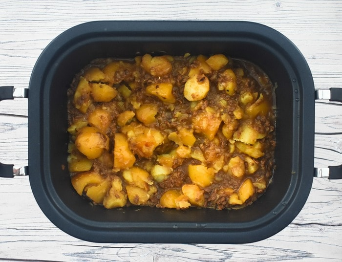 Slow Cooker Scottish Stovies (vegan) in a black slow cooker pan