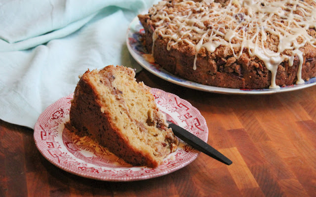 Food Lust People Love: Crunchy streusel sweetened with brown sugar and maple syrup bakes inside and on top this maple coffee cake. It's finished with a sweet maple syrup glaze for a perfect seasonal treat.