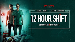 two people dressed in scrubs in a blood soaked room