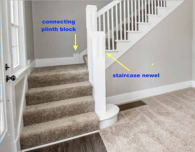 Sears Norwood model staircase newel and plinth block being used to connect trim pieces