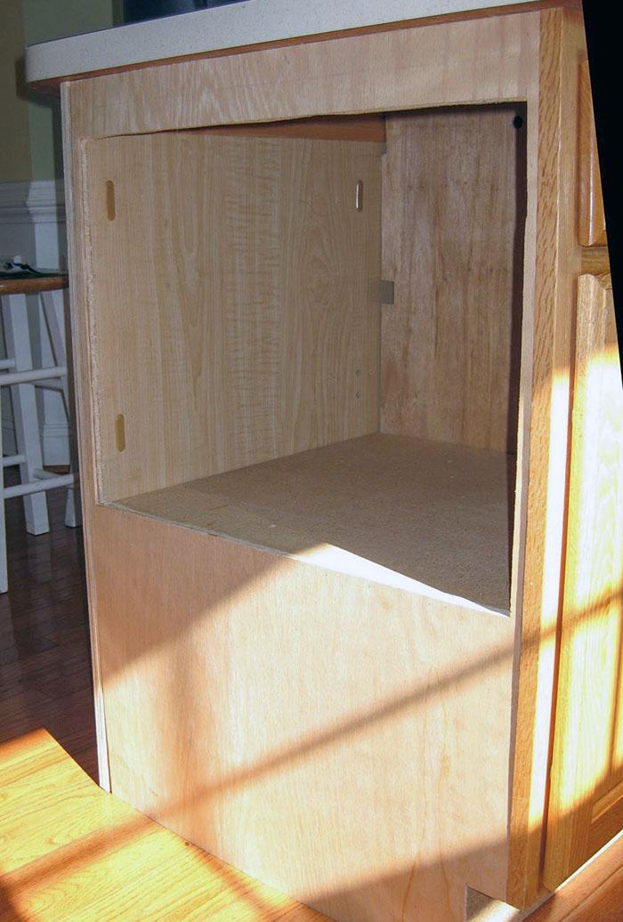Microwave inside of kitchen island