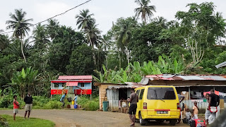 Small yellow buses in Sao Tome