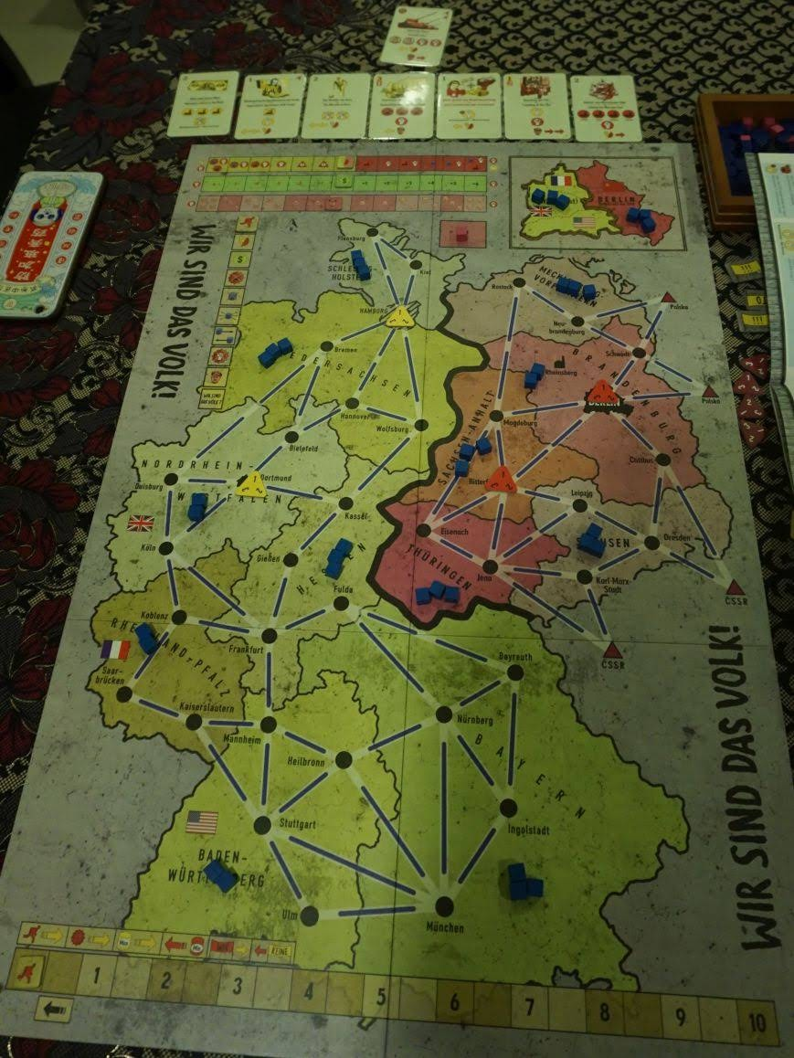 this is the starting setup the board is mostly empty most provinces already have three unrest cubes people are not happy they have just lost a war and